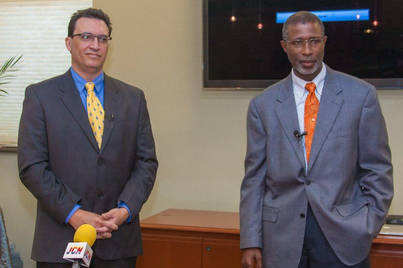 """Cable Bahamas Ltd's Head of Marketing at David Burrows (L) and Vice President of Engineering John Gomez (R) announce that the company would be launching """"mind-blowing"""" new Internet access speeds for all of their customers"""