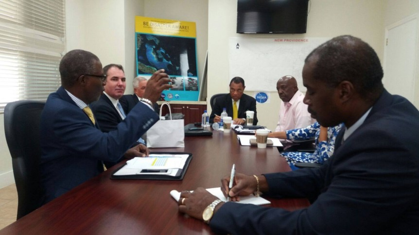 Executives of Cable Bahamas Ltd (CBL) and NewCo meet with national leaders to discuss restoration efforts at NEMA Headquarters on New Providence, The Bahamas. L-R: John Gomez, COO, CBL; Damian Blackburn, CEO, NewCo; Anthony Butler, CEO, CBL; Prime Minister of The Bahamas, The Rt Hon Perry Christie; Shane Gibson, Minister of Labour and National Insurance, and newly appointed Coordinator for the Hurricane Matthew Relief and Recovery; Allison Maynard Bahamas Attorney General; and, Captain Stephen Russell, director, NEMA.